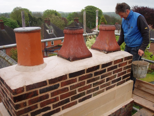 The pots back on and flaunched with lime mortar.