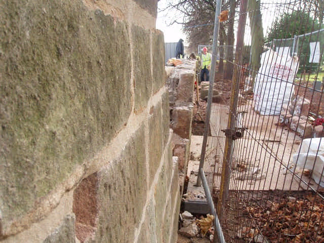 This shows the top section of the wall built plumb against the lower leaning sections.